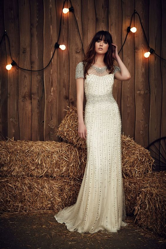 an illusion neckline wedding dress with heavy beading, rhinestones and beaded sleeves