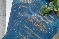 26 indigo wedding invitations with the starry sky shown and copper letters