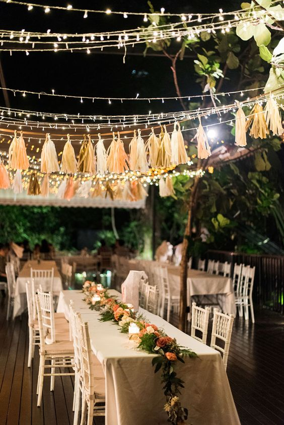 string lights and tassel garlands in matching colors create a cheerful and fun mood