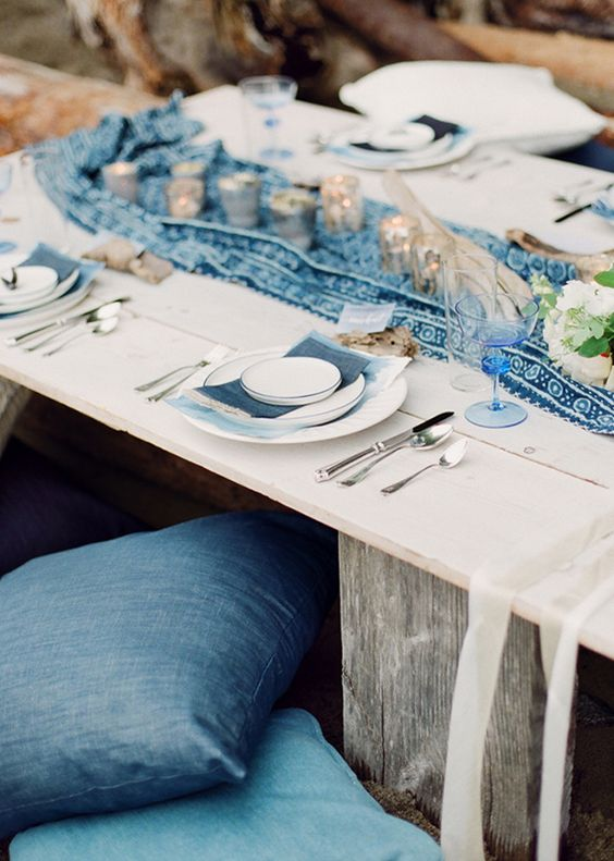 the coastal tablescape is accentuated with a printed indigo runner and indigo napkins