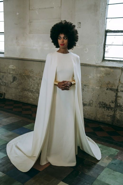 Solange Knowels's moderst wedding dress with a cape attached to the shoulders