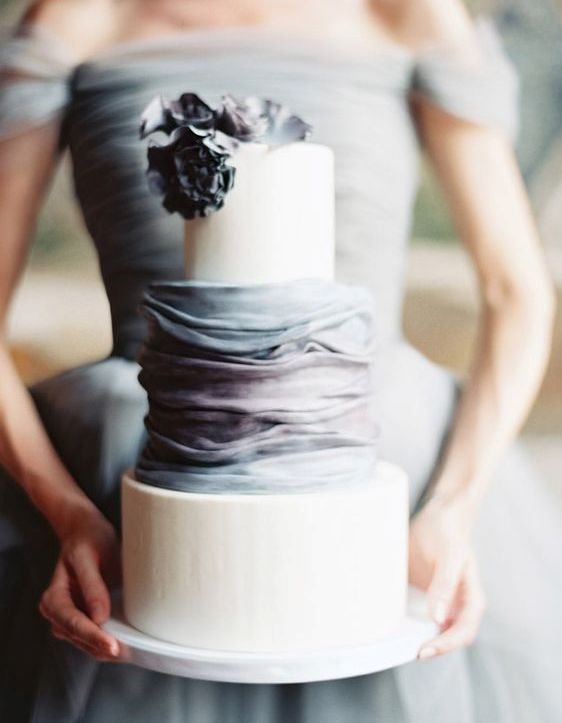 a chic modern cake with two cream layers and a grey and lavender ruffled one
