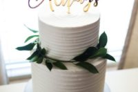 27 a white textural wedding cake topped with greenery and an Always topper