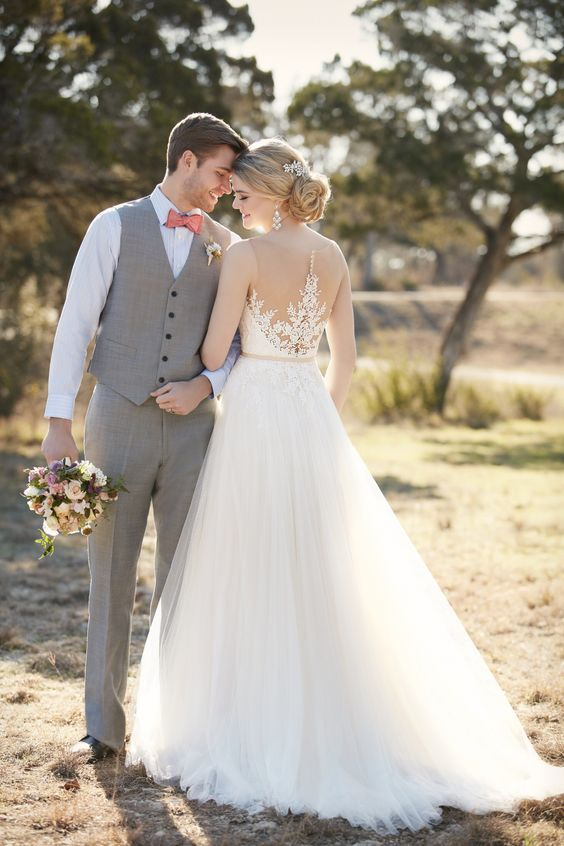 sleeveless A-line wedding dress with a tulle skirt and a lace applique illusion back with beaing