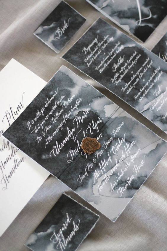 watercolor grey wedding invites accentuated with seals and threads