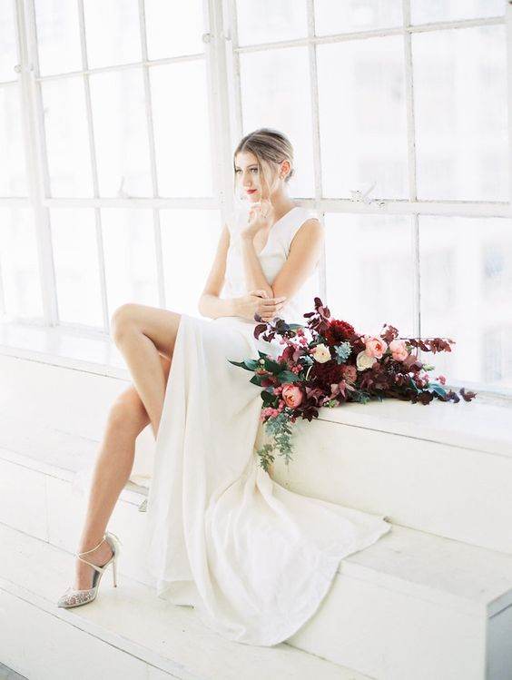 modern V-neckline wedding dress with a front slit and strappy lace heels