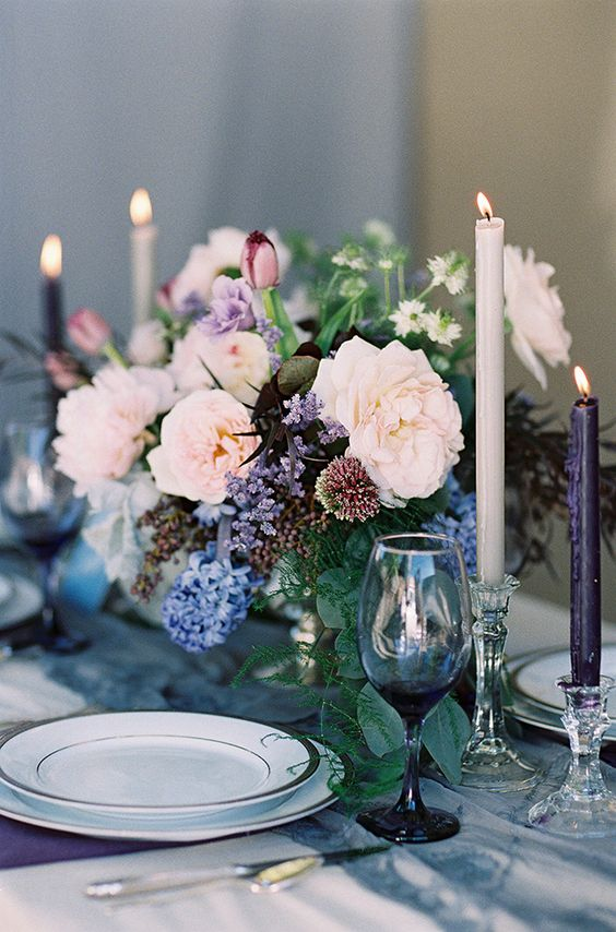 moody tablescape in purple and indog shades with an addition of pastel blooms