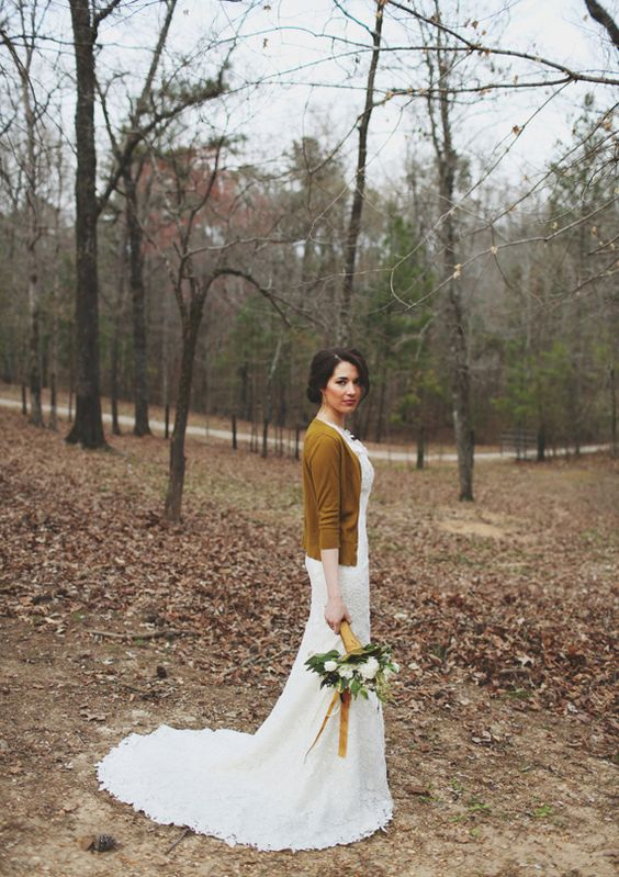 mustard wedding cardigan for a fall bride and matching ribbons on the bouquet