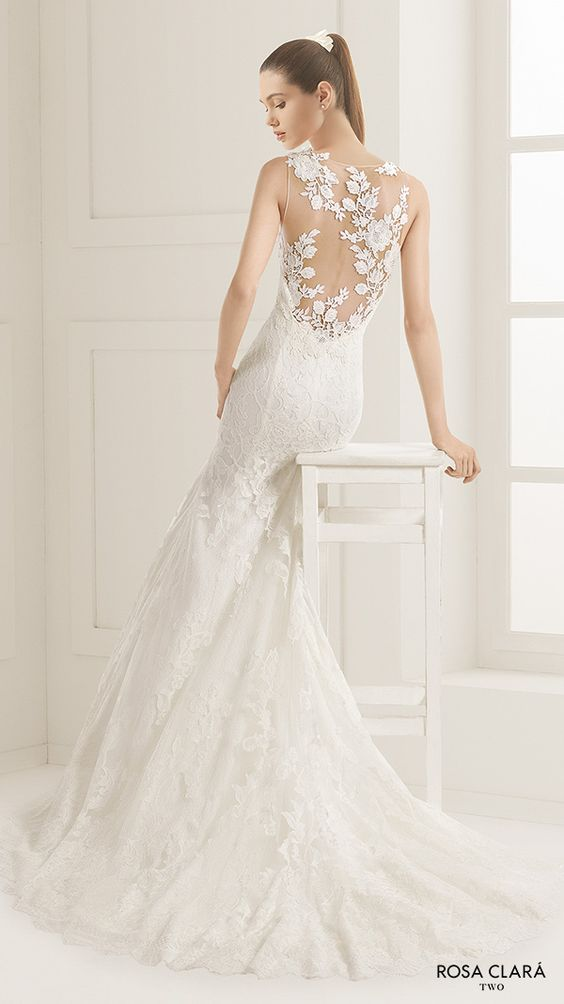 sleeveless lace mermaid wedding dress with a illusion back and lace appliques on it