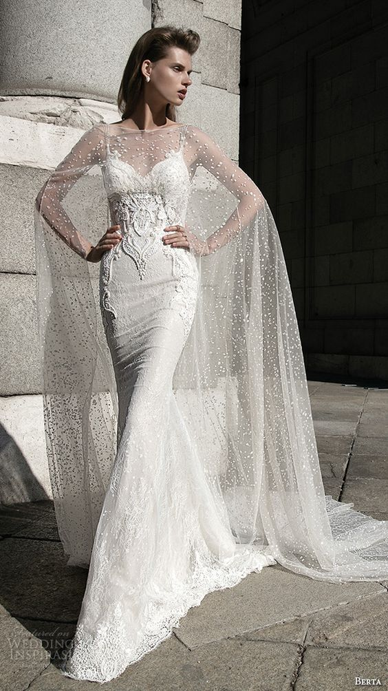 spaghetti strap lace applique wedding dress and a see through cape that reminds of snow