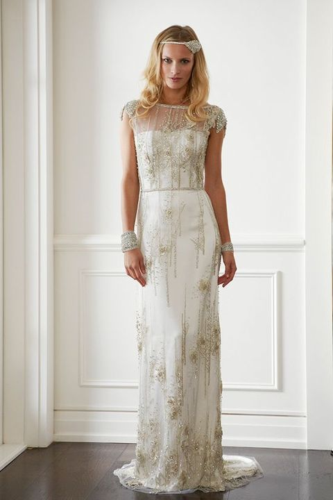 an illusion neckline wedding gown with cap sleeves and gold beading and embroidery
