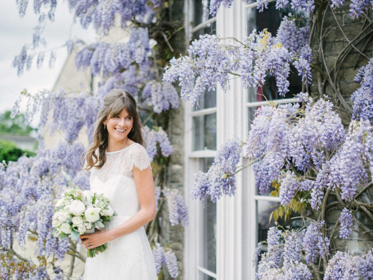 This adorable wedding shoot took place in a beautiful venue with lots of wisteria