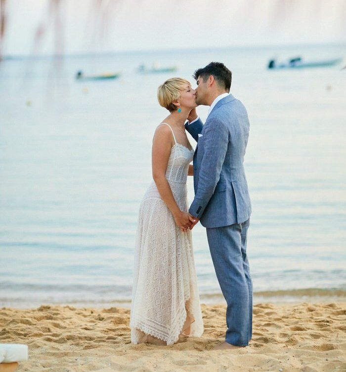 This chic beach wedding took place in Greece and was done with blue touches and much attention to the guests as they traveled from the USA
