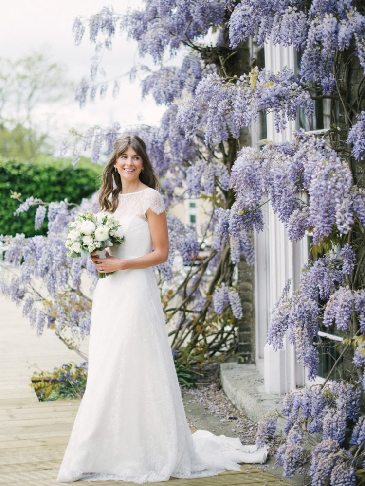 The bride was wearing a romantic wedding dress with an illusion lace neckline and cap sleeves