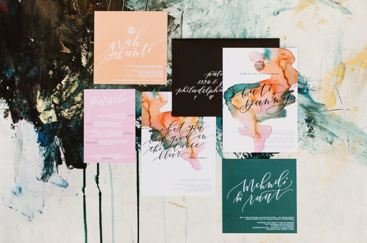 The wedding stationery was bold and colorful, with watercolour splashes
