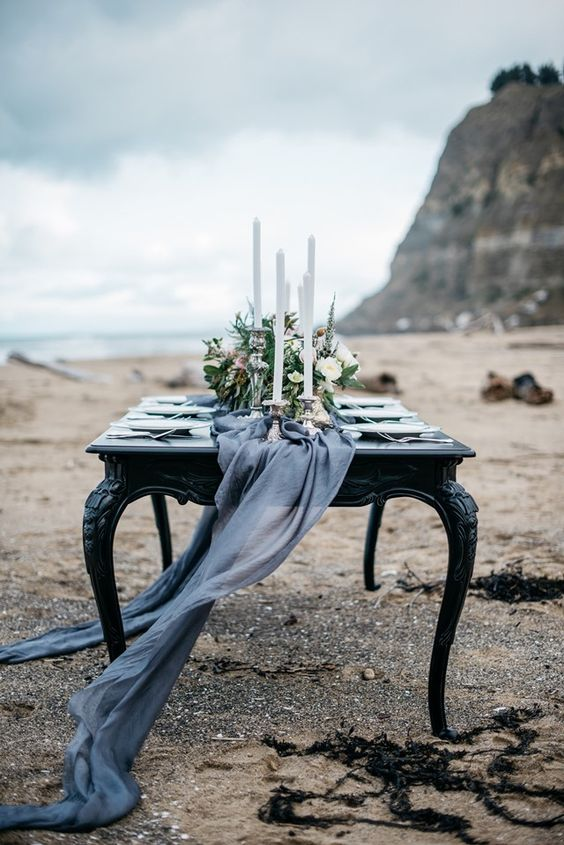 flowing graphite grey table runner for a refined winter beach wedding