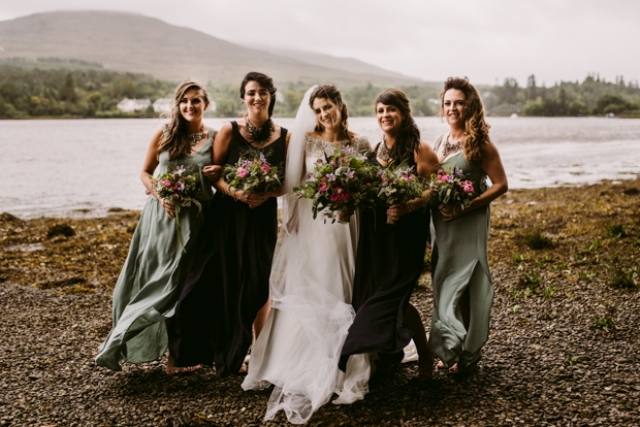 Her bridesmaids were rocking seafoam dresses and black ones to fit their style