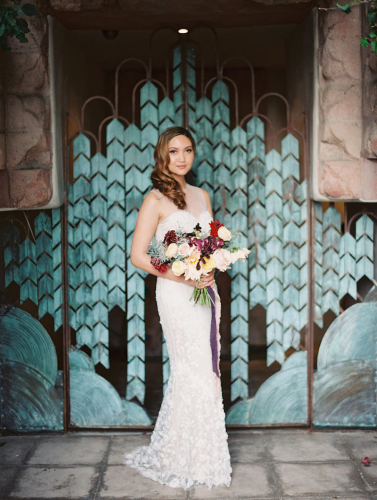 The bride was wearing a gorgeous white lace wedding dress with an illusion neckline and back and a glam retro wavy hairstyle