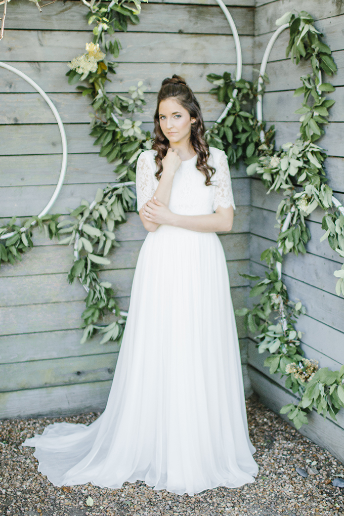 The bride was wearing a simple wedidng gown with a lace bodice with short sleeves and a plain skirt