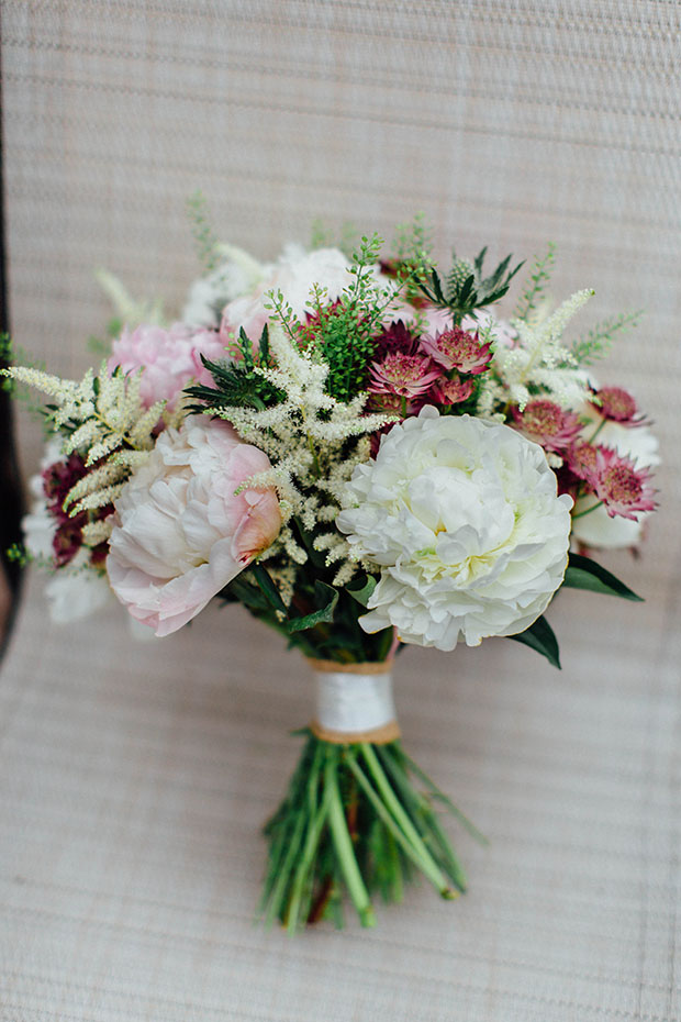 The wedding bouquet was simple and rustic, with blush, neutral and burgundy touches