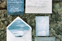 03 a coastal wedding invitation suite in the shades of blue and greyand calligraphy looks moody and dreamy