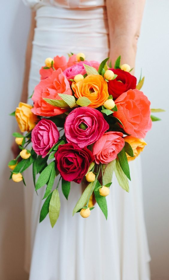 a colorful tissue paper flower bouquet in fuchsia, orange and yellow