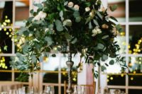 03 a eucalyptus and small blush roses centerpiece on a tall stand looks very elegant and chic