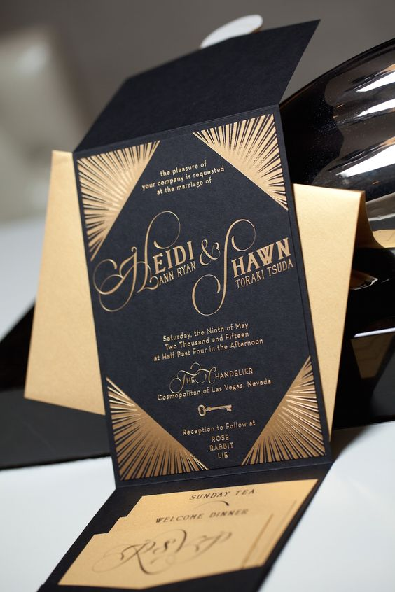 black and gold foil wedding stationery with calligraphy and beams