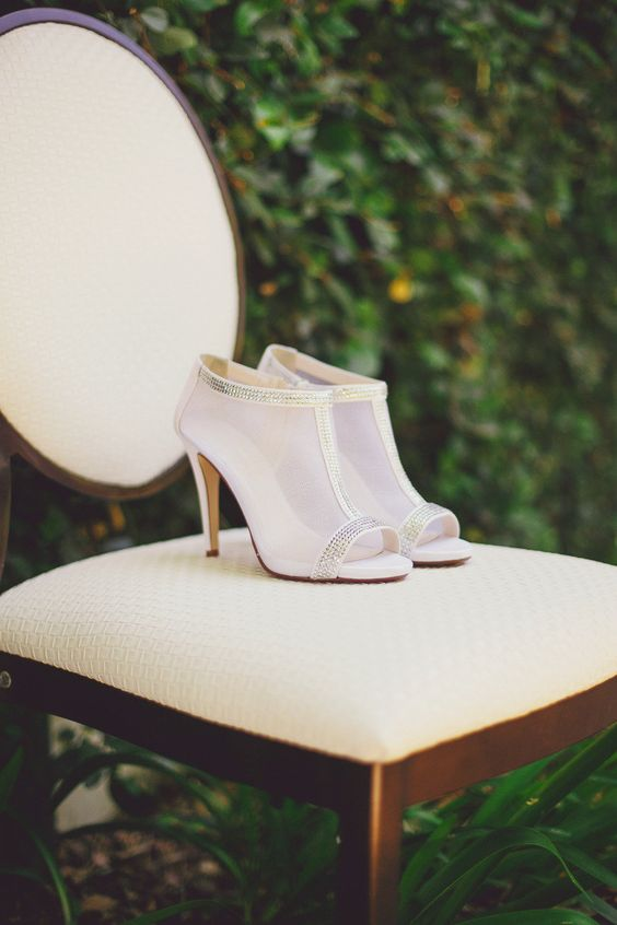 modern sheer peep toe booties with rhinestone lining for a stylish modern bridal look