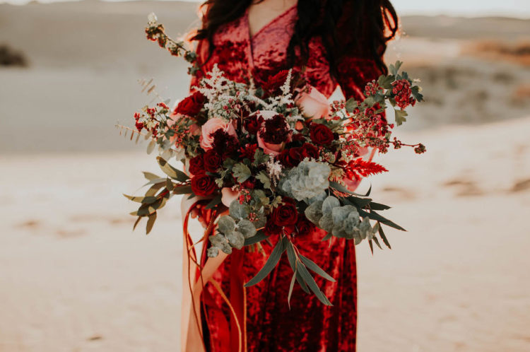 The bridal bouquet was created to complement her red velvet dress