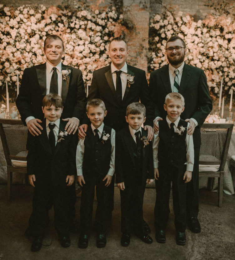 The groom was rocking a black suit with a black tie, and so were the groomsmen