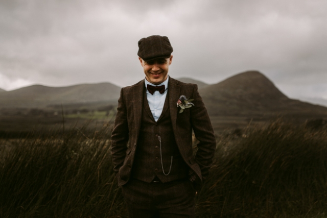 The groom was wearing a vintage brown wedding suit, a cape and a bow tie