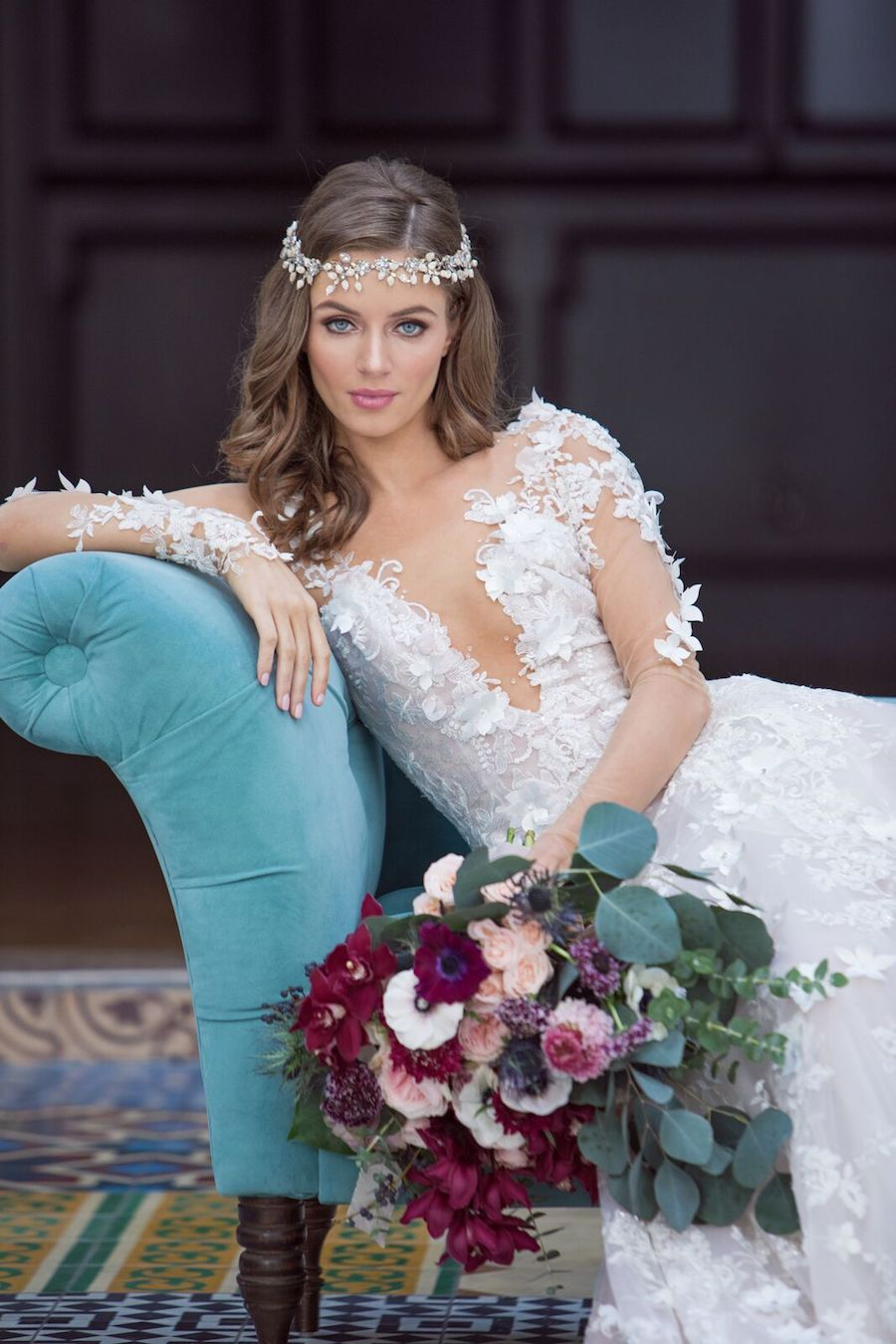 The next wedding gown is a plunging neckline one, with illusion sleeves and floral appliques all over