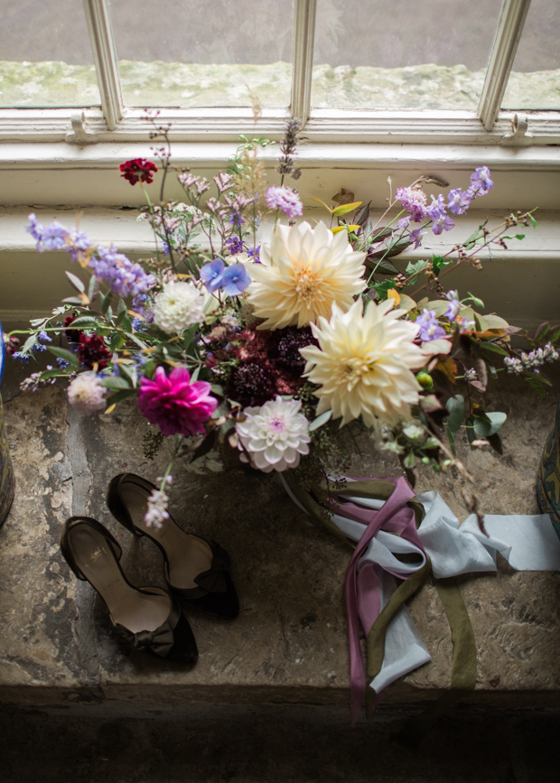 The wedding shoes were of black suede and silk, anf the bridal bouquet was done of various garden and wild blooms