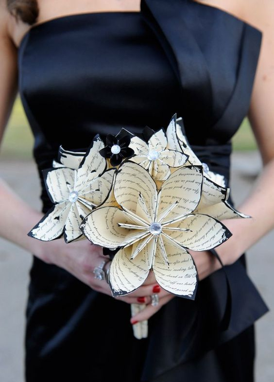 a book paper bridesmaids' bouquet with rhinestones for a book-lover wedding