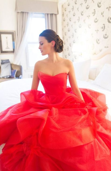 a fiery red wedding ballgown with a sweetheart neckline and a ruffled skirt