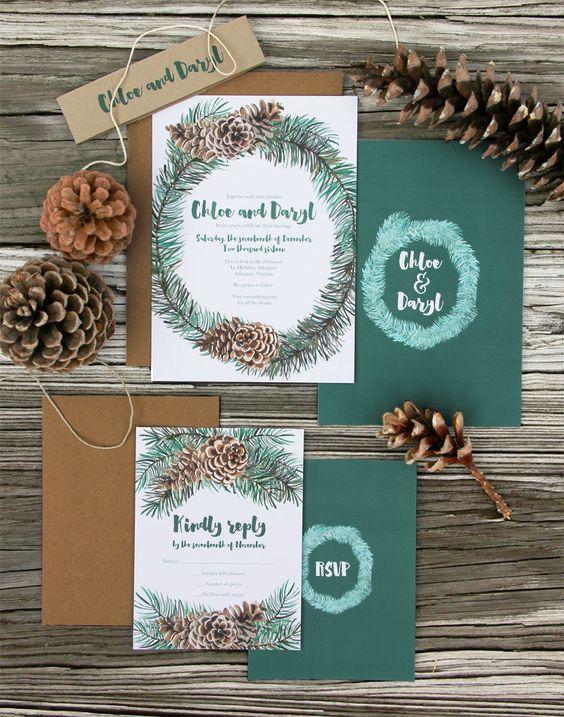 a rustic Christmas stationery suite in dark green and with pinecone prints and kraft paper