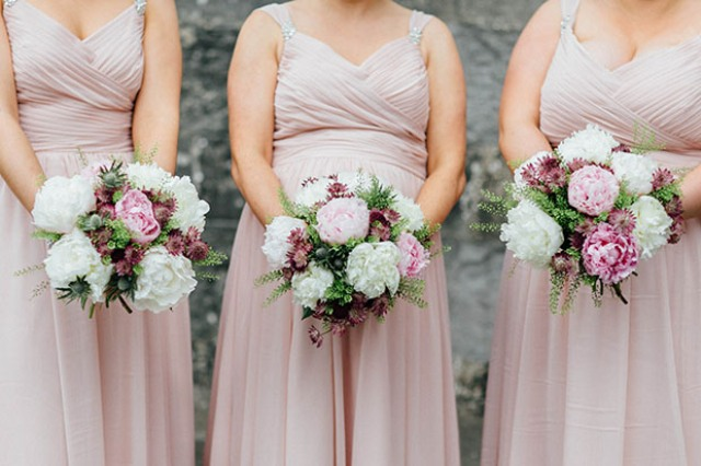 The bridesmaids were wearing blush pink dresses with straps and with draped bodices