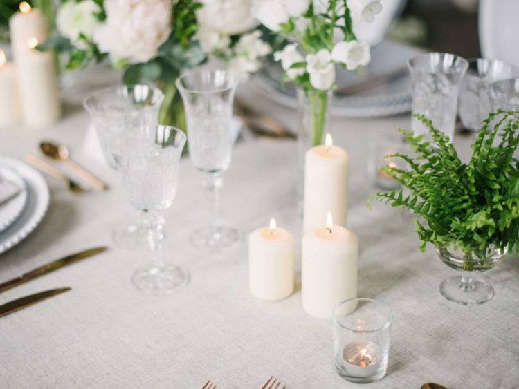 The wedding table was done with gold cutlery and neutral candles