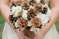 05 a cute rustic bouquet with pinecones and white blooms looks sweet and winter-like