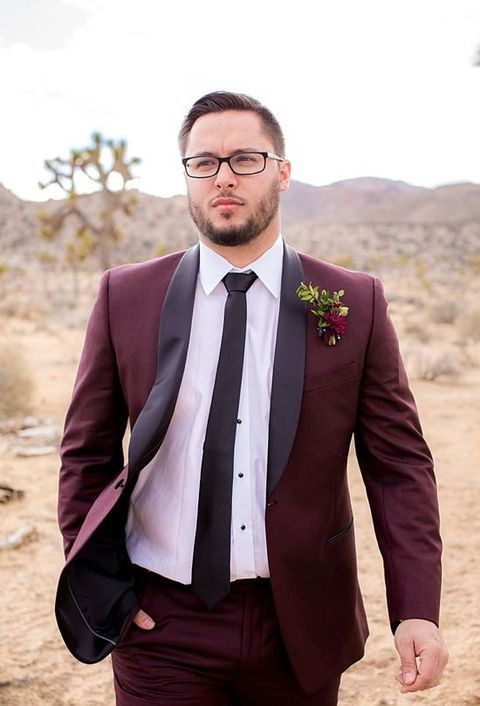 a groom wearing a marsala suit for a difeerent yet very elegant look