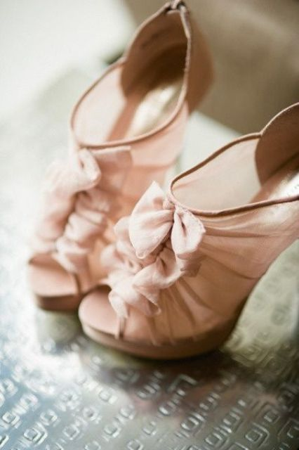 sheer blush wedding booties with peep toes and ruffles for a trendy bride