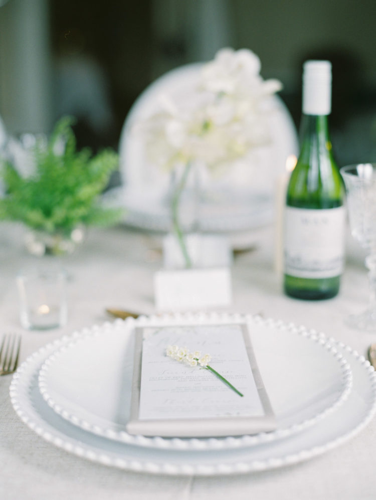 Neutral napkins and chic chargers looked refined and airy