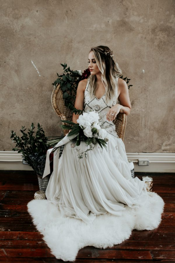She was rocking a white bouquet with greenery