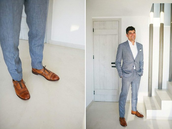 The groom was wearing a blue grey suit, a white shirt and brown shoes for a cool seaside look