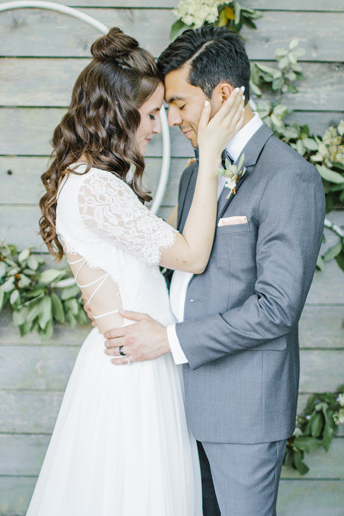 The groom was wearing a grey suit with a grey bow tie