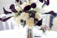 06 a floral centerpiece of white roses and deep purple callas looks unusual and bold