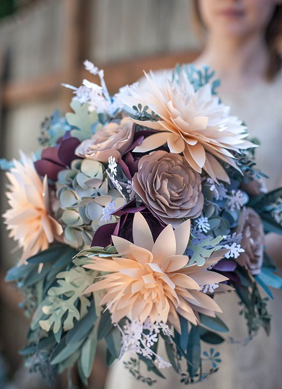a unique wedding bouquet done of paper flowers looks pretty natural