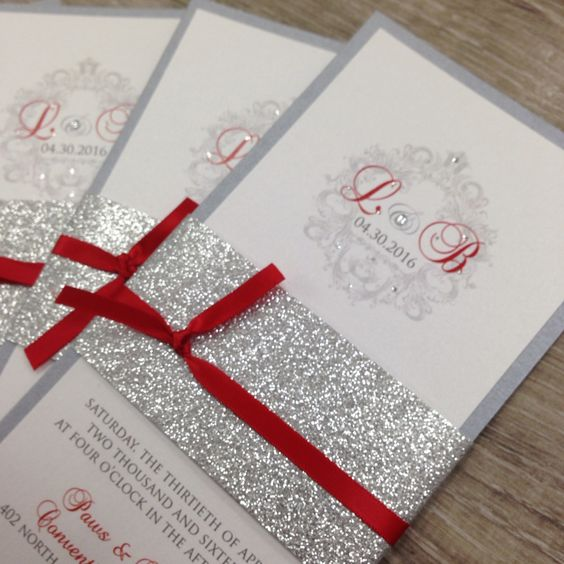 picture of grey silver glitter and red wedding invitations for a sparkly glam christmas wedding