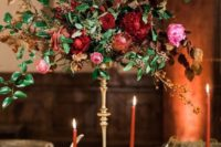 07 a gorgeous wedding centerpiece with red and pink flowers and textural foliage